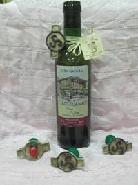 Botella de sidra y tapón escanciador